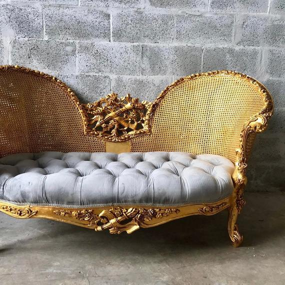 A wonderful French Sofa. The sofa was recently upholstered with tufted velvet and the massive handmade beech wooden frame...