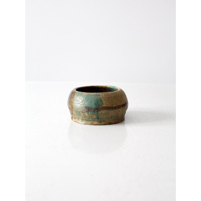A vintage artist signed studio pottery bowl. The textured ceramic bowl features a beautiful blue and green glaze. Jen...