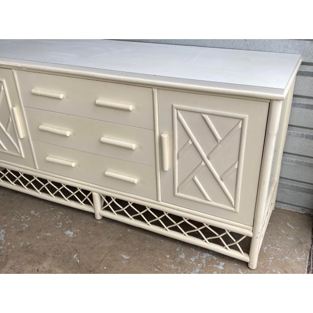 Gorgeous Coastal bamboo credenza. Beautiful bamboo design details. Laminate top added for additional practicality. Lots of...
