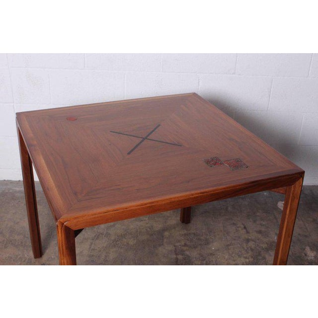 A rare walnut game table designed by Edward Wormley for Dunbar with ceramic tiles by Otto and Gertrude Natzler.