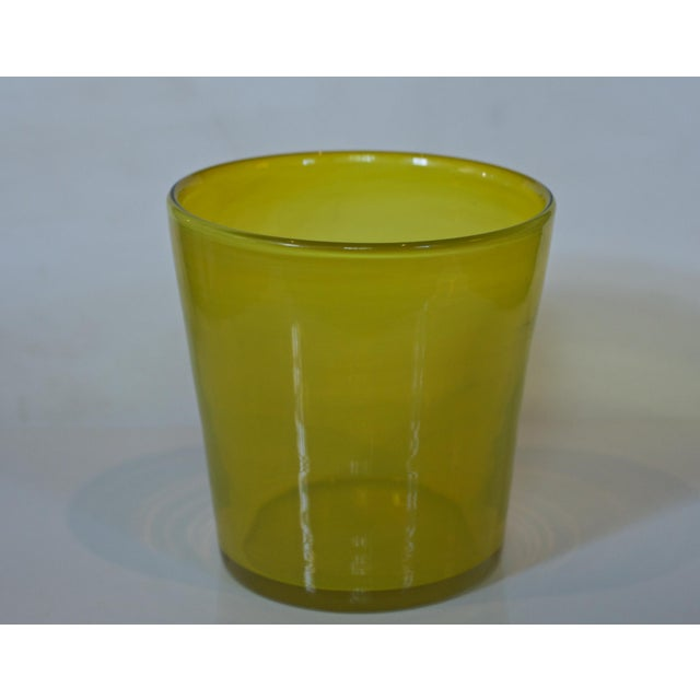 A vintage art glass ice bucket in a fetching a bright citron yellow / green . An entertaining must have. Nice quality,...