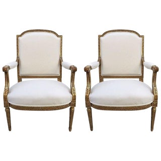Pair of French Louis XVI Style 19th Century Giltwood Carved Chairs For Sale