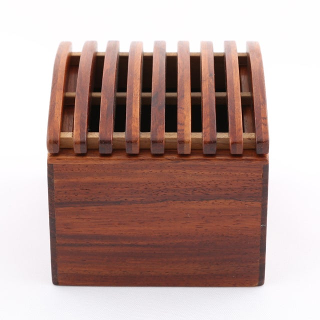 Exotic wood box with gently arched, ribbed lid. Jerry Madrigale worked for Knoll's Design and Development division for...