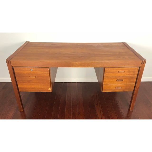 Vintage Danish teak desk by Bent Silberg. A comfortable balance between a typical student desk and executive desk size....