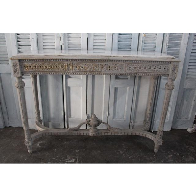 Vintage French console made of solid oak and complete with a fitted white Carrara marble slab insert. Newly refinished...