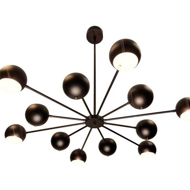 Introducing the Supernova chandelier-- a dynamic, lively design by Blueprint Lighting, 2019. Supernova is constructed with...