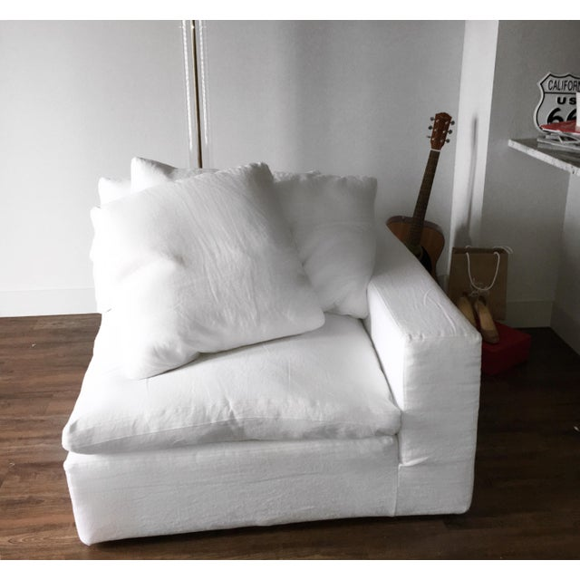 This chair is less than one-year-old, barely used and like brand new. This corner chair is from Restoration Hardware Cloud...