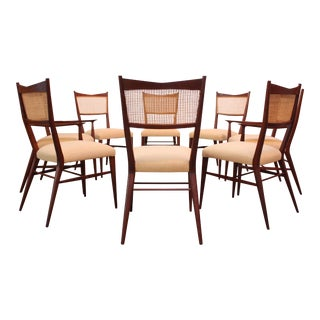 Set of Eight Stained Mahogany and Cane Directional Dining Chairs by Paul McCobb For Sale