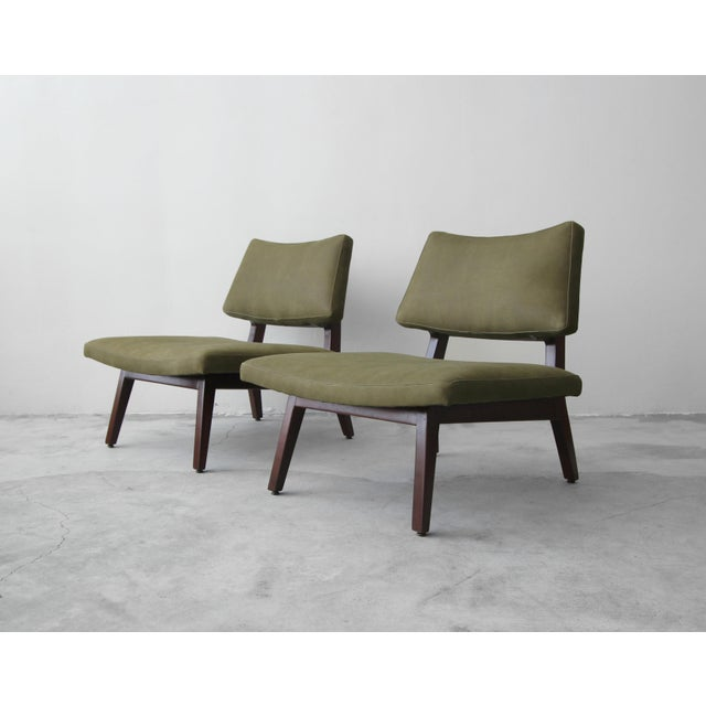 Stunning pair of sculpted side chairs by Jens Risom. A gorgeous pair of mid century slipper style chairs with oversized...