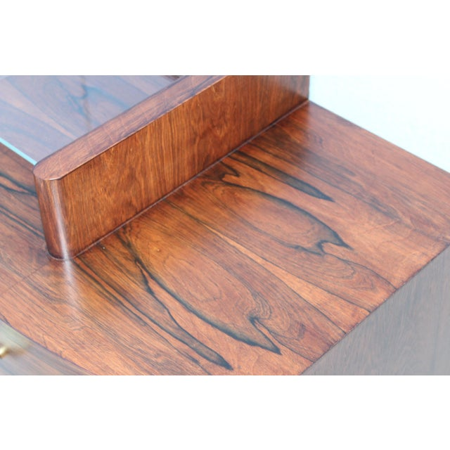 Stunning 1940s Gilbert Rohde designed for Herman Miller Model number 3770 vanity, made of Brazilian rosewood with 3...