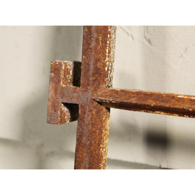Pair of cast-iron window bars from a mental asylum. Each grid is 11 9/16″ x 6