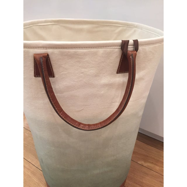 This dipped dyed Fade Tote Fabric Bin with leather trim can go anywhere in a living room or playroom for blankets, pillows...