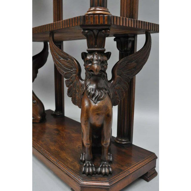A Pair of Mahogany English Regency Style Carved Winged Griffin Whatnot Curio Stands in the R.J. Horner Style. Item...