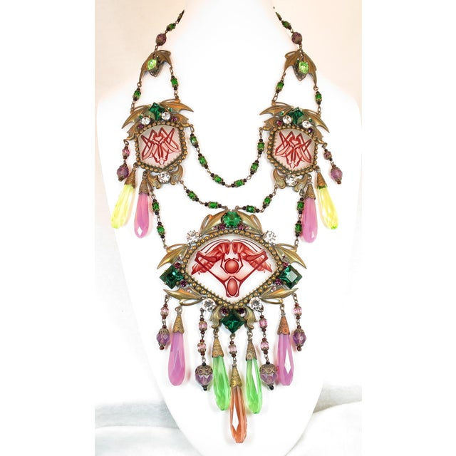 Offered here is a massive Czech Art Deco Egyptian Revival draping necklace of etched and painted glass panels and multi-...