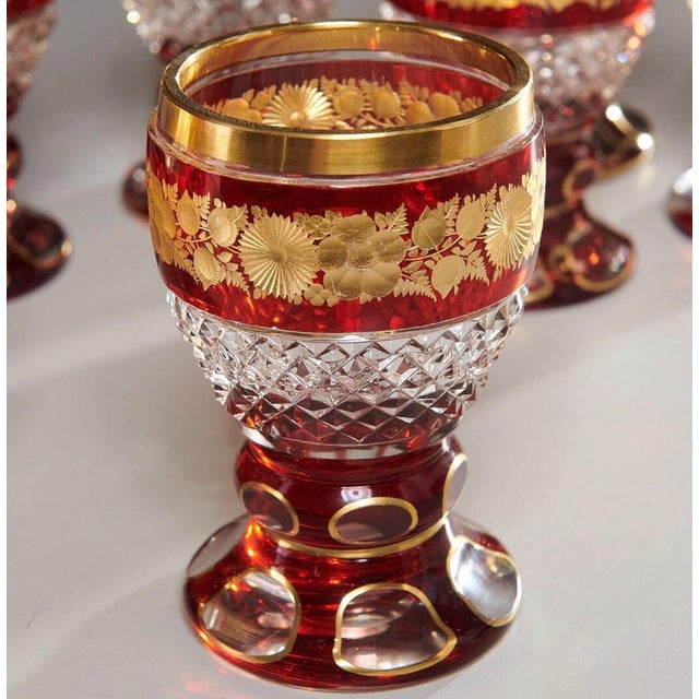 Cut clear and ruby glass, with gilt floral banding.
