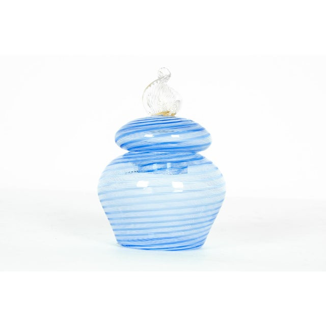 Vintage Murano glass vanity jar with sky-blue swirls and decorative finial. All in excellent condition. The jar measure...