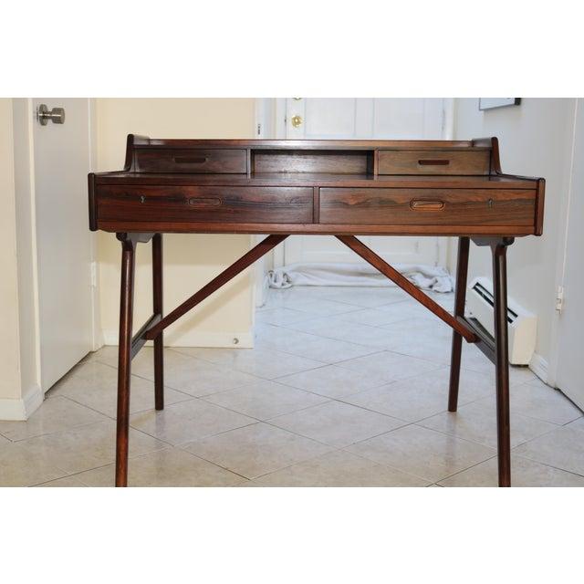 Up for sale is a Vintage Arne Wahl Iversen Model 64 Rosewood Desk Produced by Vinde Møbelfabrik in Denmark. The desk is in...