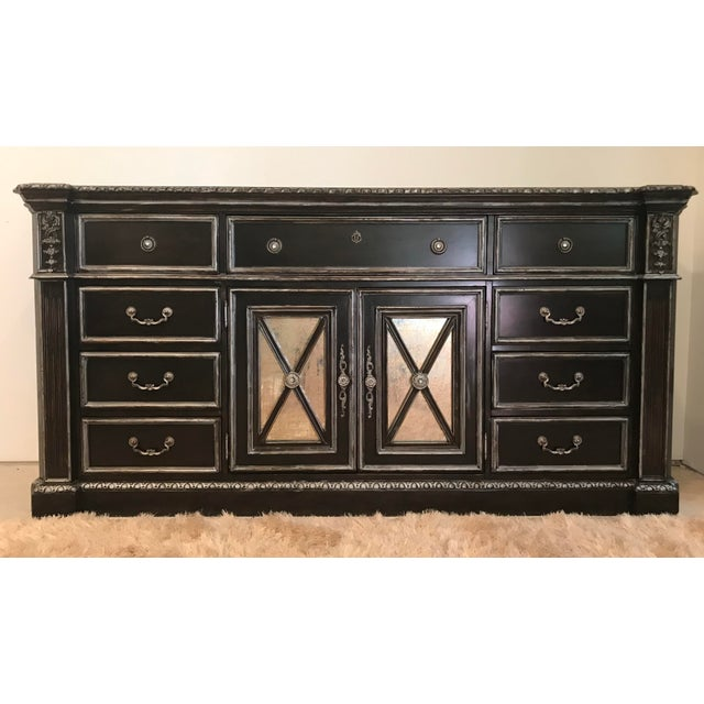 This solid wood Philippe Langdon dresser has been decoratively carved for maximum aesthetic appeal, and the raised framing...