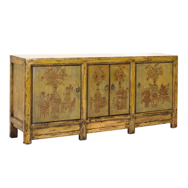 This is an oriental cabinet finished with distressed rustic yellow green color. The scenery on the drawers and doors is...