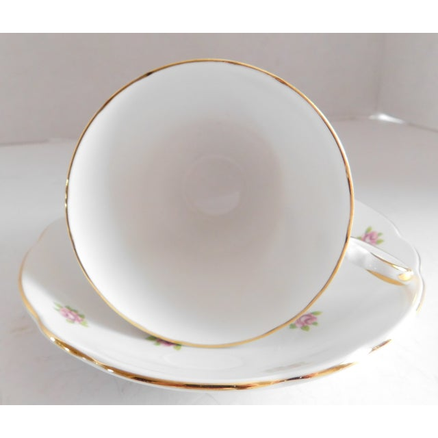 This sweet rosebud and white porcelain tea cup and saucer set is a real charmer. It is Regency English Bone China, made in...