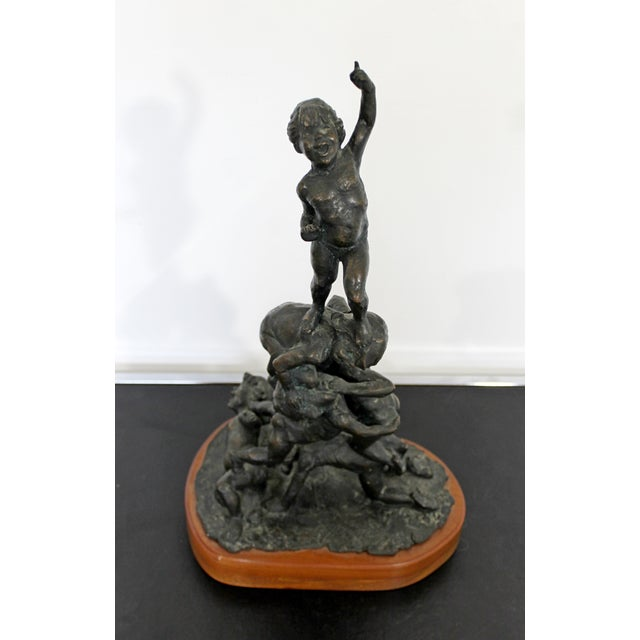 For your consideration is a marvelous, bronze table sculpture, on a wood base, signed Edward Chesney, and dated 1972. In...