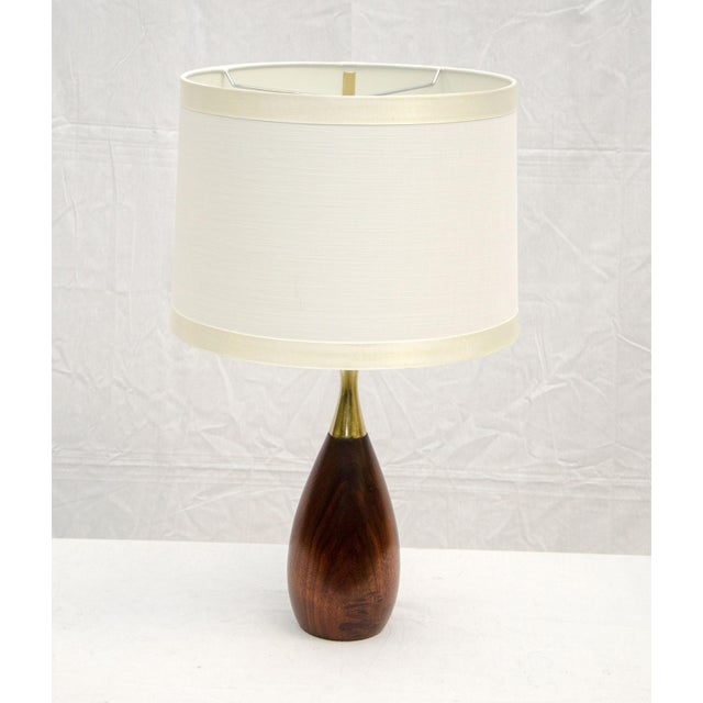 Medium size Tony Paul walnut and brass table lamp. Perfect for use on a desk, a dresser, or just a great accent light....