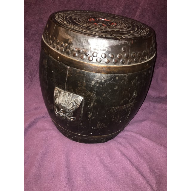 An antique Chinese rice barrel with ornamentation throughout. 14 inches tall by 1 foot across. Lovely wood.