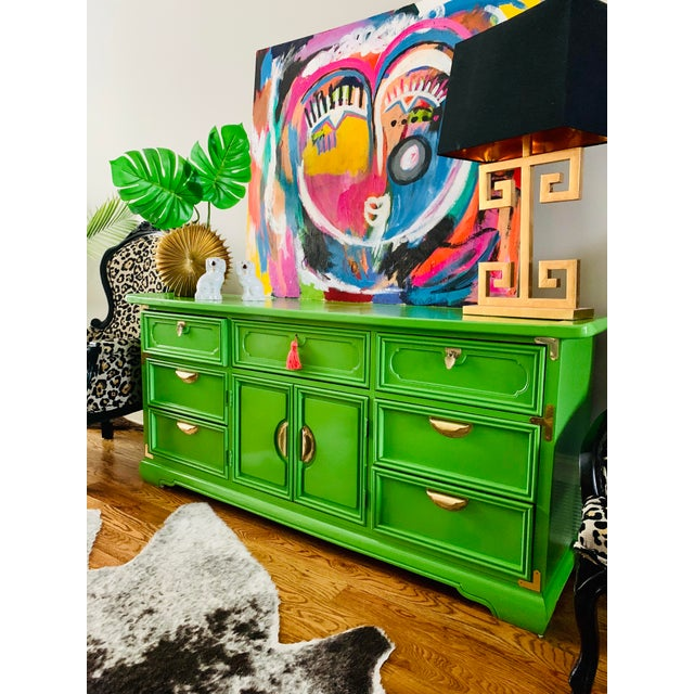 This gorgeous solid wood pagoda top Credenza is lacquered in a gorgeous green. Timeless and classic. This is sure to...