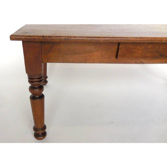 Early 20th century child's bed turned coffee table. Beautiful, simple turned legs, nice patina. Drawer added later on.