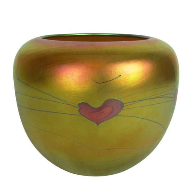 Beautiful art glass pot shape vase from Lundberg Studios. Blown glass in gold luster color with a red heart and vine...