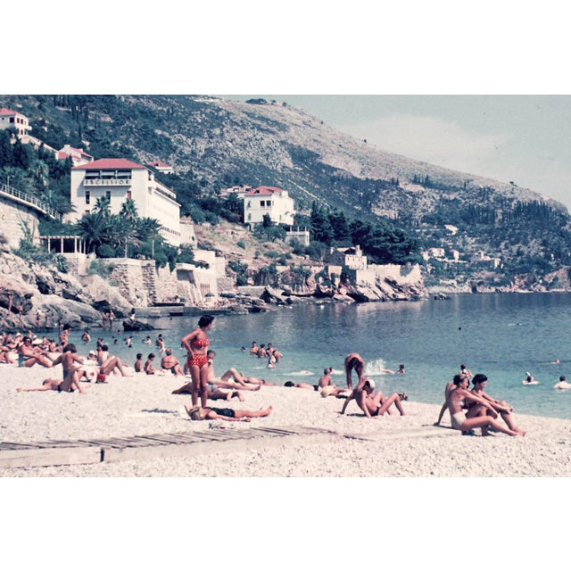 A classic beach scene at the Excelsior Hotel in Dubrovnik, Croatia (Yugoslavia at the time) circa the 1960s. This...