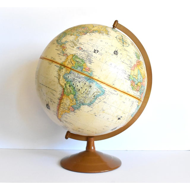 "A vintage 12"" globe by Globemaster, by cartographer Leroy M. Tolman, with a slight relief to the topography, and a copper-..."