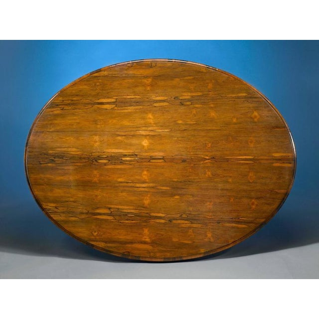 A fine Victorian rosewood tilt-top table. This exceptional table displays a remarkable, skillfully matched grain as its...