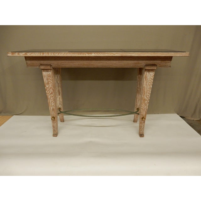 Unusual cerused oak French Art Deco console with black glass top, great design. Tabletop has 3 squares of black glass.