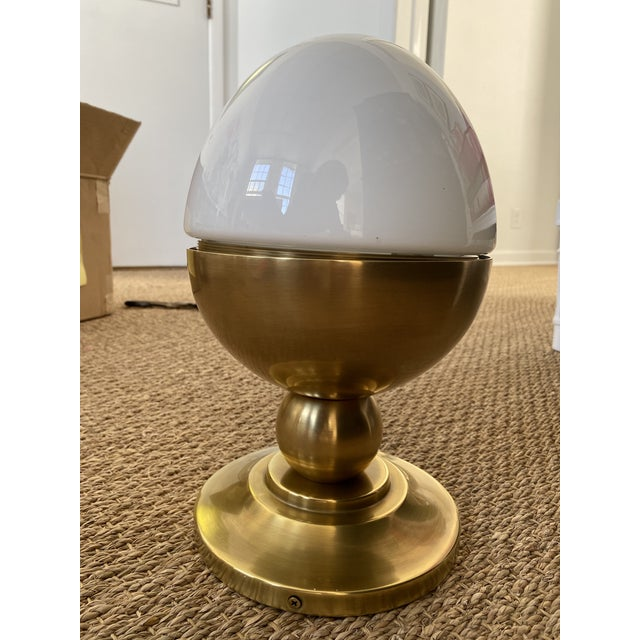 Two available - Hand-rubbed Antique brass flush mount with a white glass. This flush mount light is designed by Thomas...