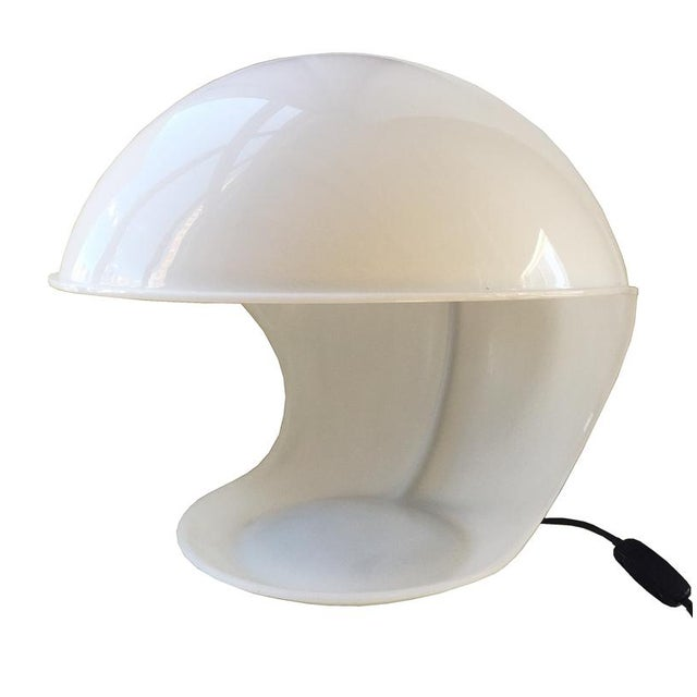 """Table lamp model """"Foglia"""" by the designer Elio Martinelli in white methacrylate reflector (acrylic glass). A well-rounded..."""