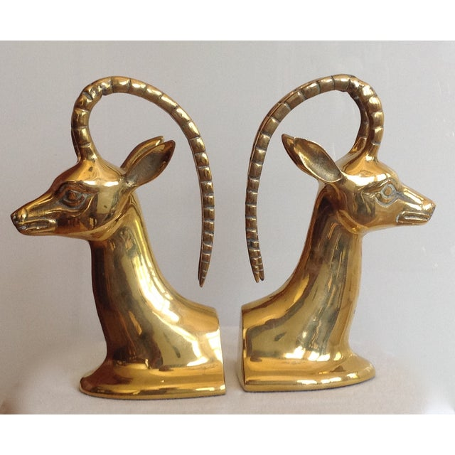 A 1960's, Mid-Century iconically distinctive and heavy pair of brass ibex bookends. In great condition for use and era,...