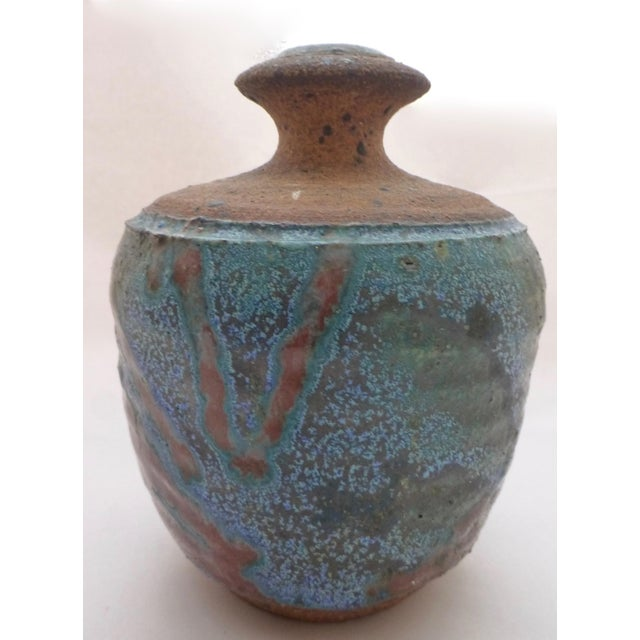 Fun and functional vase, produced by the Lyman Pottery Shack, circa 1960s. Located in beautiful Laguna Beach, and noted...