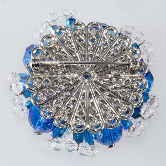 d92f84cd265 Cluster brooch made with peacock blue crystals tipped with clear rhinestones.  Smaller clear faceted glass