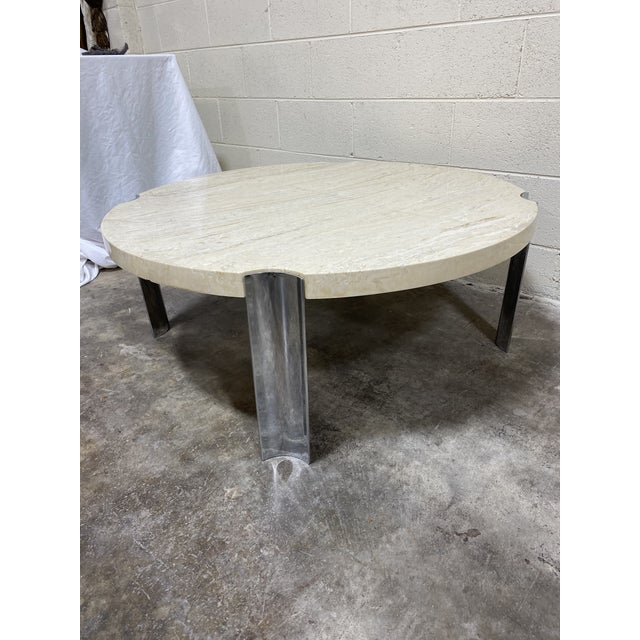 This is a classic and sexy mid century coffee table. Thick polished travertine marble top with wide chrome legs. This...
