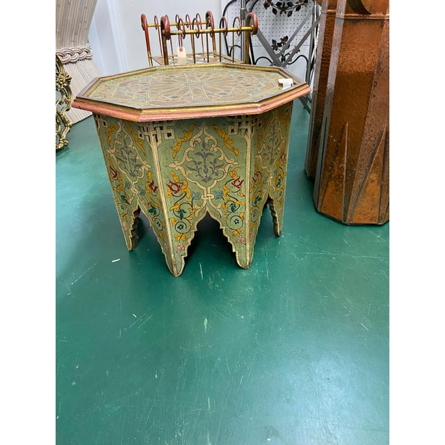 Oriental inspired hand painted accent table. Moorish, Moroccan, or Indian floral motifs and shapes makes this piece...