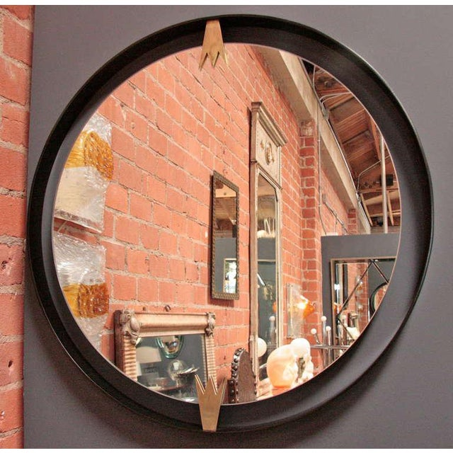 Chic design with a nod to the past, this moderne mirror mimics good taste.