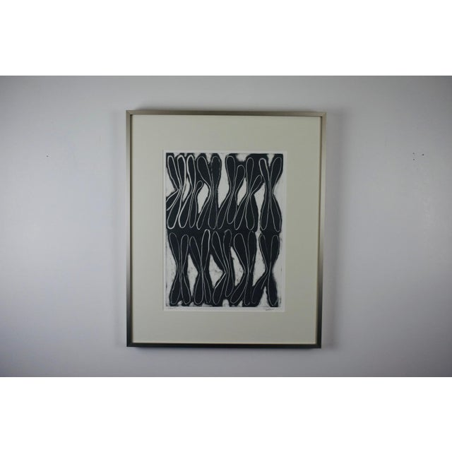 Artist Joan Ffolliott has envisioned a black and white world in this monotype, entitled 'Split' and created by the...