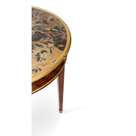 Stylish Louis XVI style guéridon featuring marquetry and bronze accents. Drawer opening for storage. Marble top. Quite...