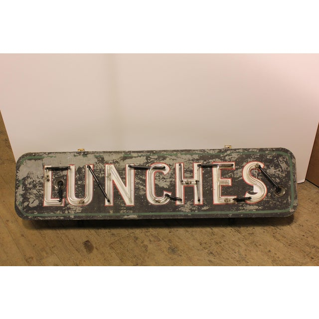 1930's neon sign Lunches. It has new wiring and new transformer.
