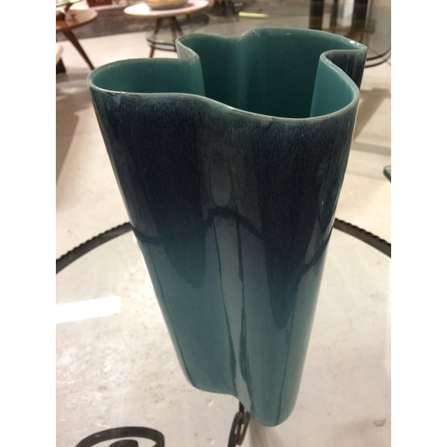 Gorgeous shade of blue with darker topping at the top. Beautiful shape with a splash of color for any room.