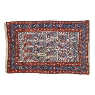 Vintage Persian Kurdish Rug With Blue Boteh Pattern - 4′ × 6′ For Sale