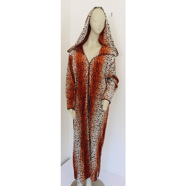 Moroccan animal print hooded caftan in light fabric with black trim embroidered, circa 1970s. This light summery djellabah...