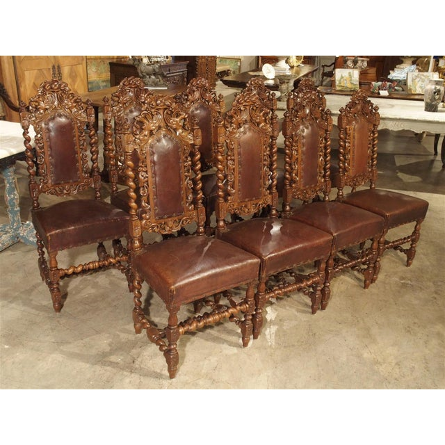 These beautifully carved antique walnut wood French dining room side chairs  date to around 1880. - Incredible Set Of 9 Antique Walnut And Leather Dining Chairs From
