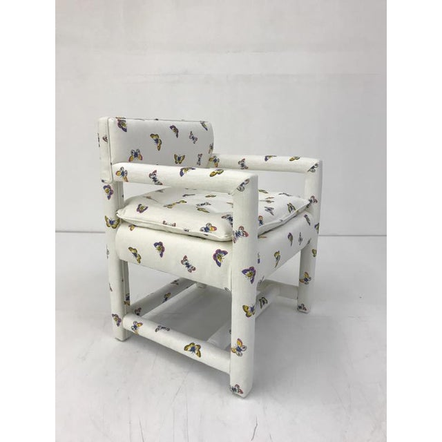 The Morehead Chair is a first quality market sample that features a White-Patterned Fabric in a Tight Back Style.